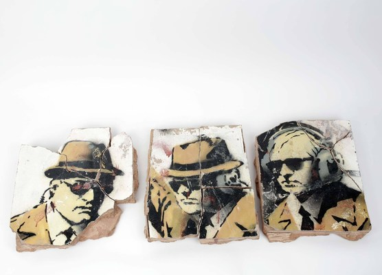 Remaining pieces of Banksy's Spy Booth mural offered by Cosmic Wire.